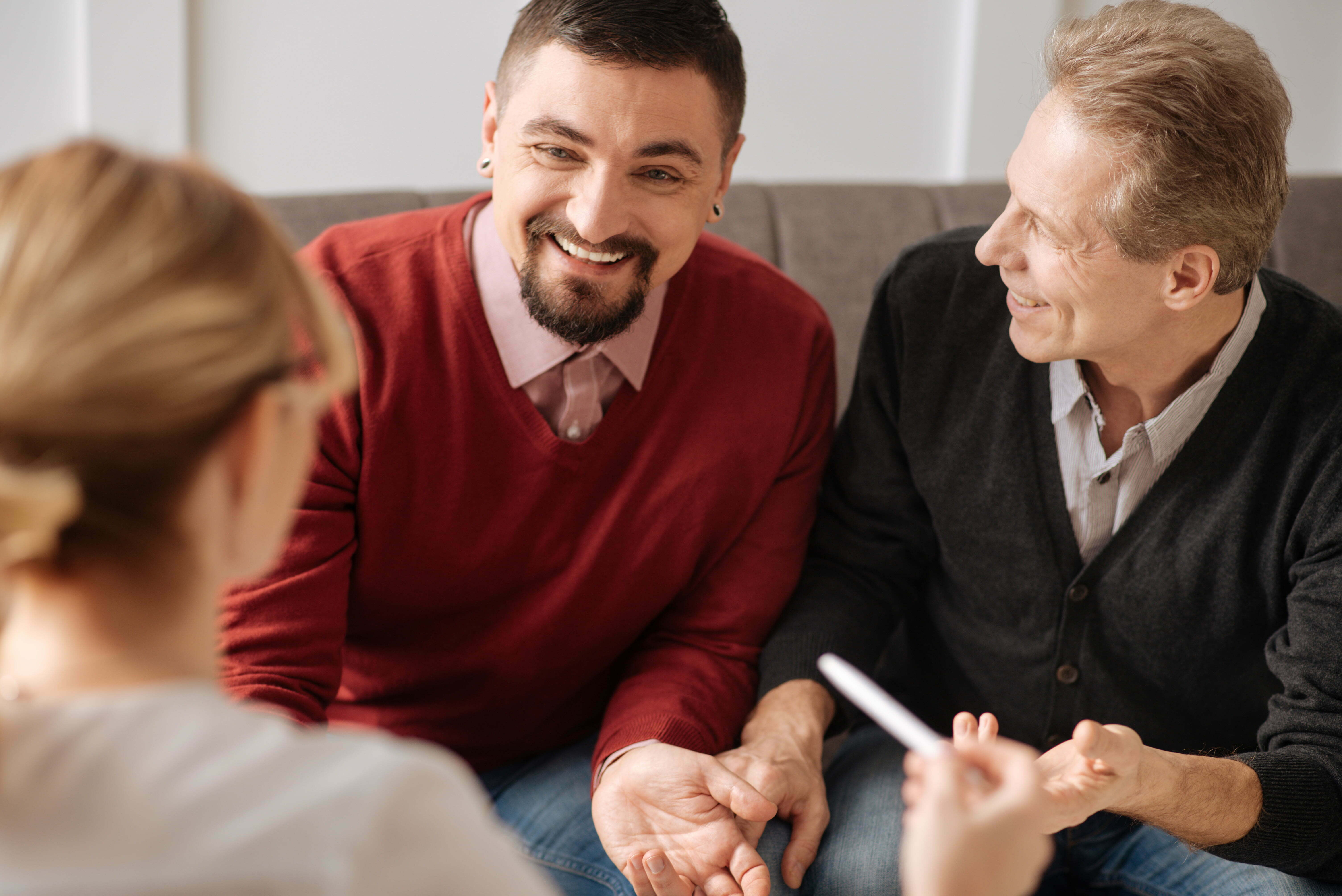 LGBT couple meeting with a case manager