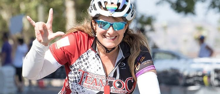 LGBTQ+ woman riding in the Annual Orange County Ride for AIDS event