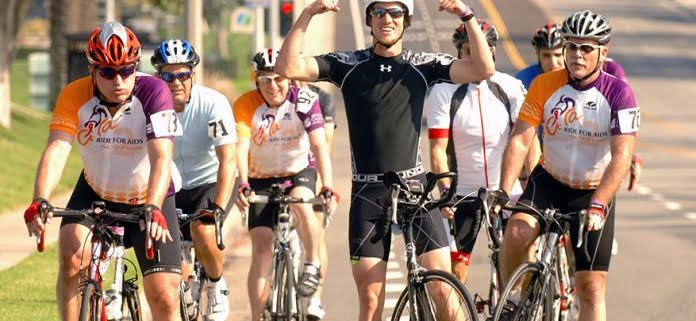 Group of LGBTQ+ cyclists riding in the Annual Orange County Ride for AIDS event