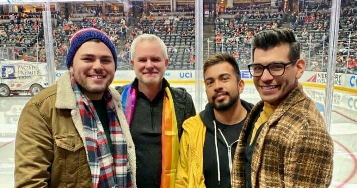 Members of the LGBTQ+ community enjoying a hockey game in Orange County